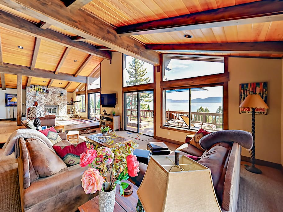 Expansive windows, high ceilings, and a spacious living area draw guests in.