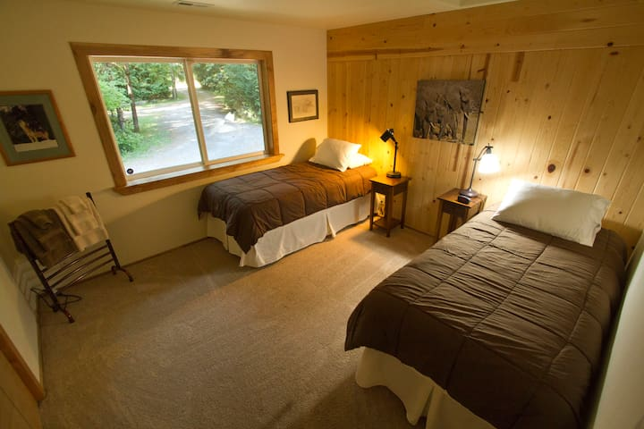 Third bedroom in the home (2 extra long twin beds and a towel heater in the corner)