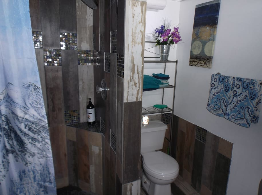 "Rustic style bathroom with ""wooden"" shower- just like one in Flip or Flop! Huge shower head! Sink with touchless faucet!"
