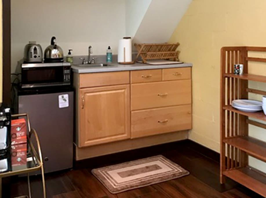 Little kitchenette for your convenience. Includes coffee maker, toaster, refrigerator and microwave.