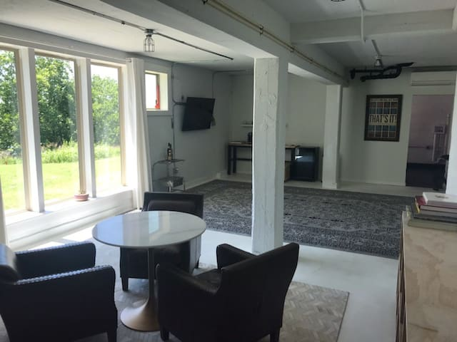 Living room / den - bathroom.  Floor to ceiling windows view to Taylor Mustang Creek Golf Course.