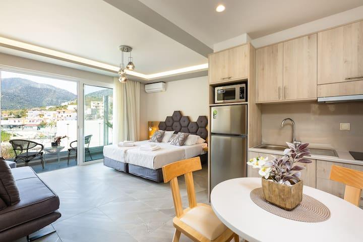Triple Studio with Mountain View in Akrogiali Luxury Aparthotel