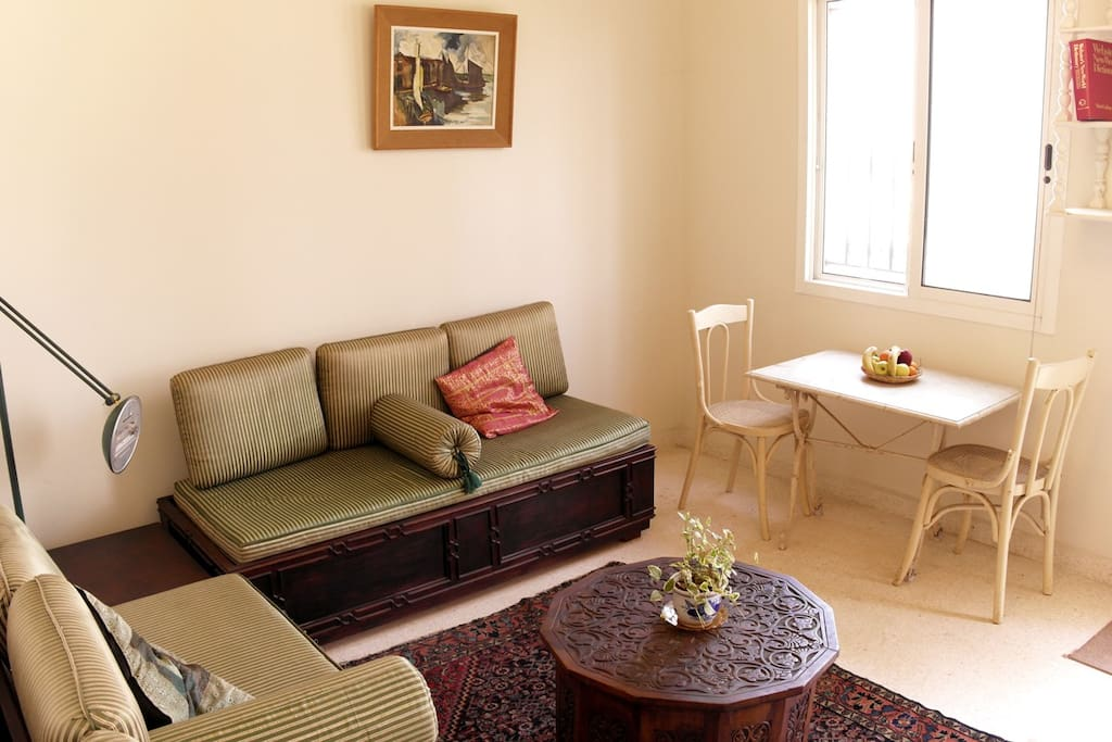 The bright living room with vintage furniture