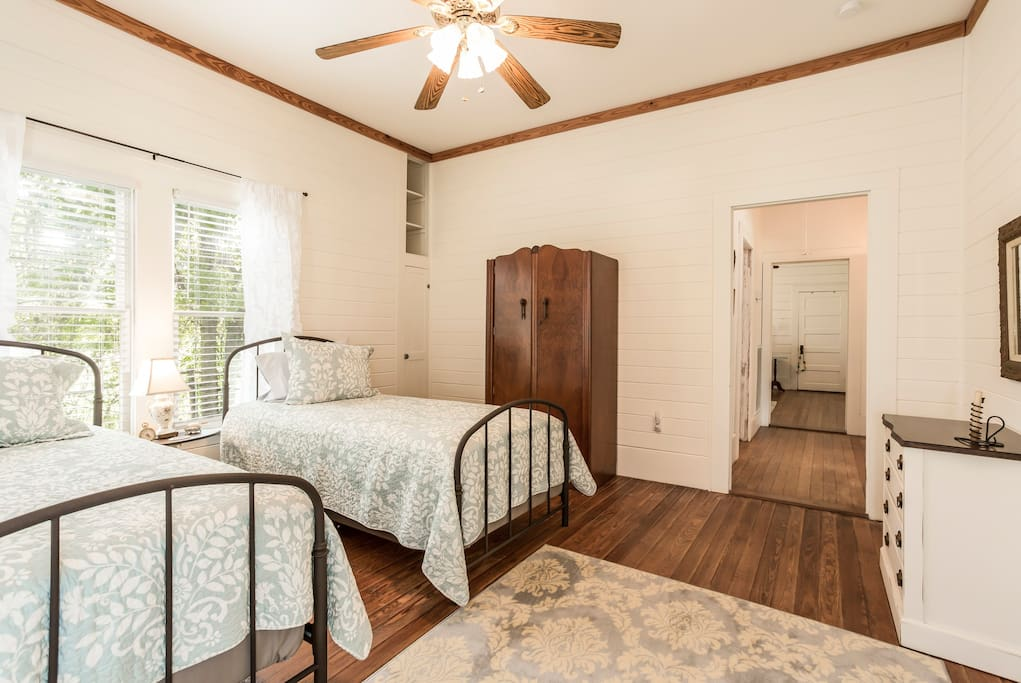 Front bedroom with two twin beds.
