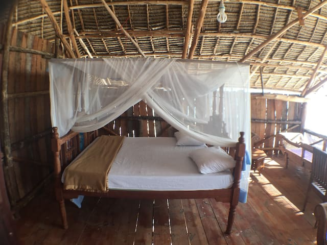 Your bed with mosquito net