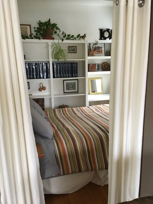 Downstairs queen bedroom with privacy curtains