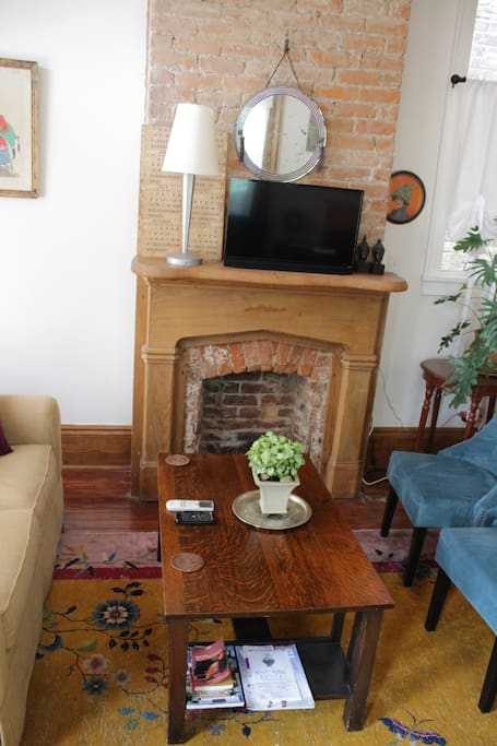 Original fireplace with original cypress mantel