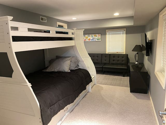 Lower level with twin over full with twin trundle and a futon.