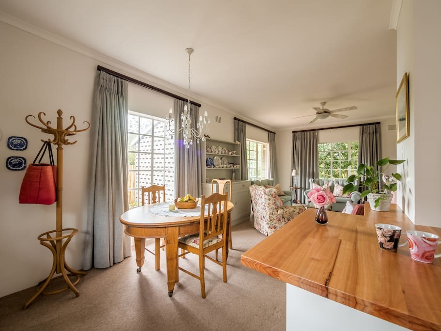 Bright and fresh open plan living with a dining table in the spacious living area.