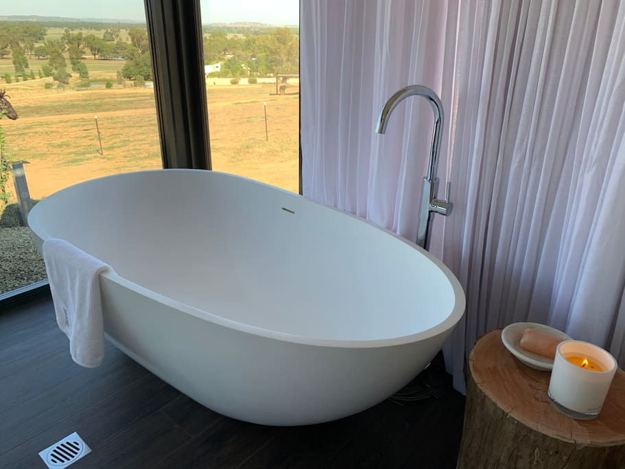 Deep relaxing stone bath tub with magnificent views!
