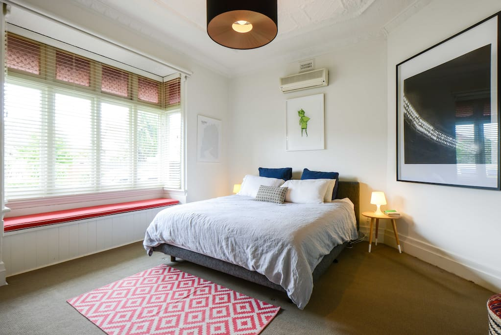 Main Bedroom with bay window and ensuite, looking out to leafy avenue