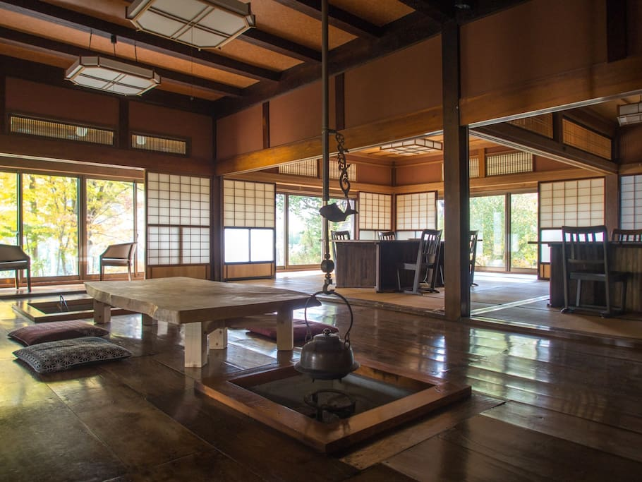 Main space in 1st floor; ancient style dinning, irori, tables and engawa.
