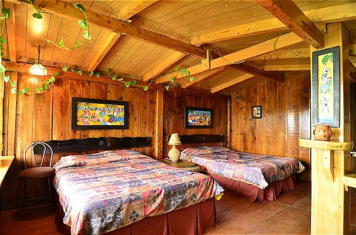 Juayua's rustic bedroom with amazing view