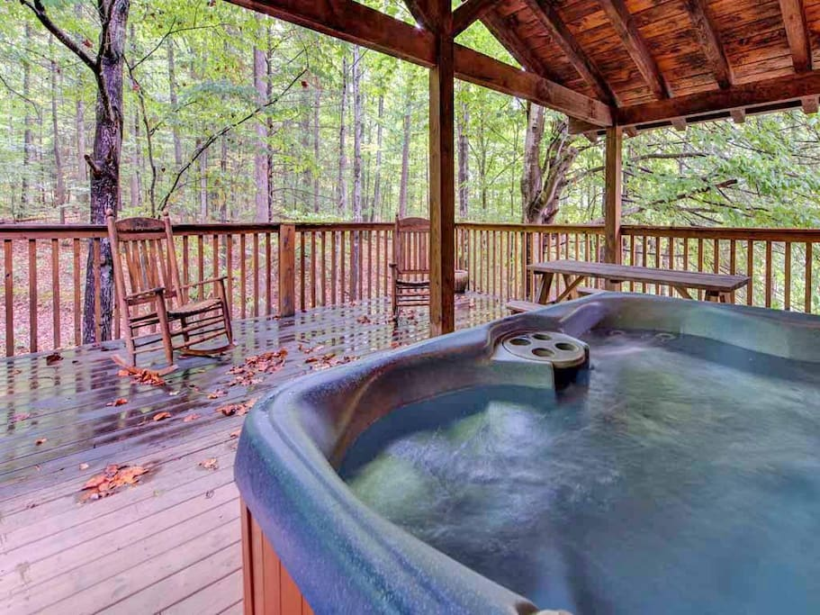 You'll have a blast rain or shine - Because the deck's hot tub sits under a roof, you can bask in its steamy jets even during a r