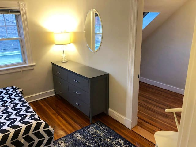 Pan of master bedroom, plenty of storage and skylight lit walk-in closet