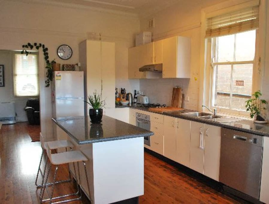 Open plan kitchen with gas and dishwasher.