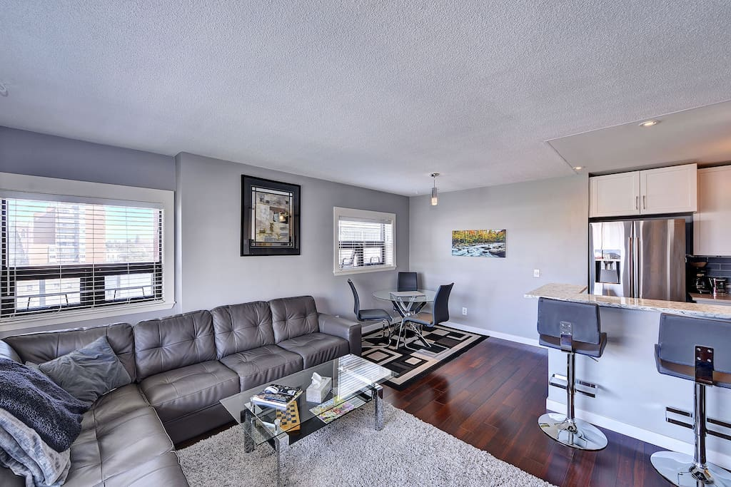Spacious open concept living and dining area, with sit up bar