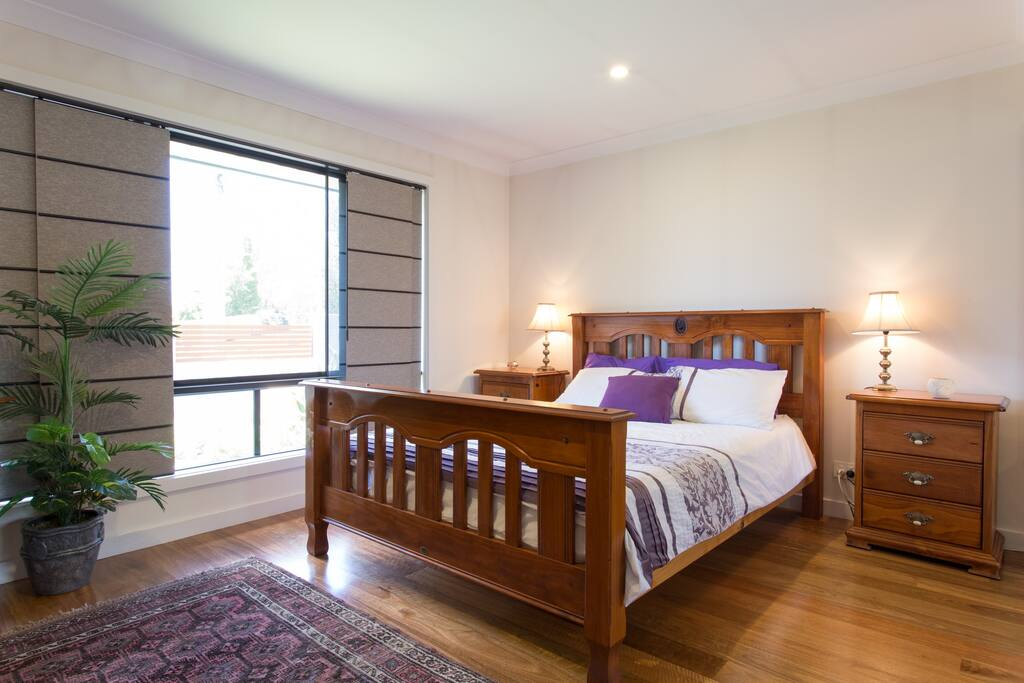 This is the guests queens sized bed which overlooks garden.  There are security screens which allows our guests to have the window open if desired