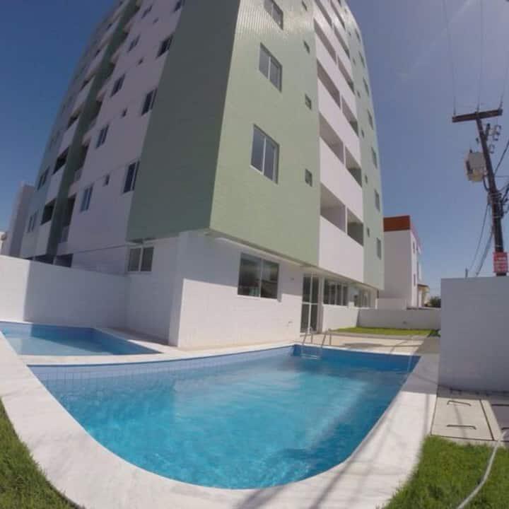 Alugo Suíte em Apt residencial com vista ao Mar