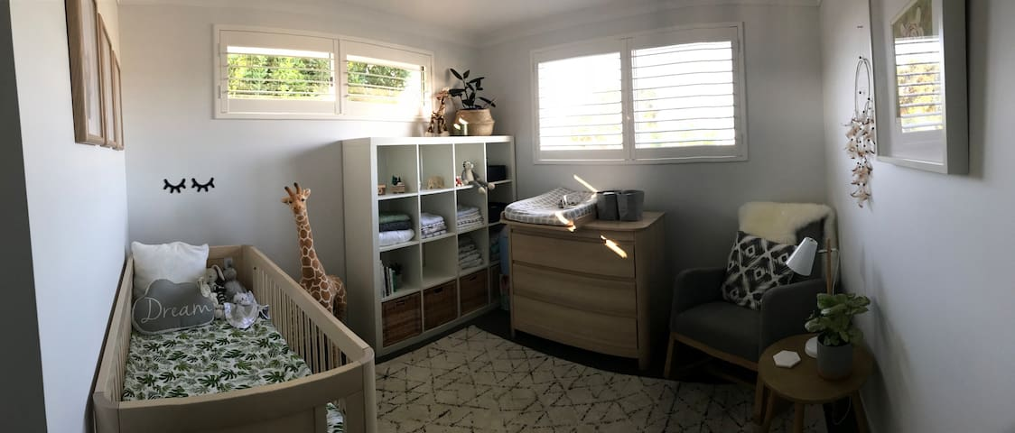 Bedroom with Cot, chair and change table