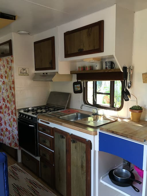 this is the kitchen, fully stocked for any cooking needs, full stove and oven, fridge...