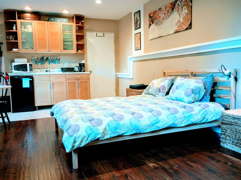 Queen bed and kitchenette
