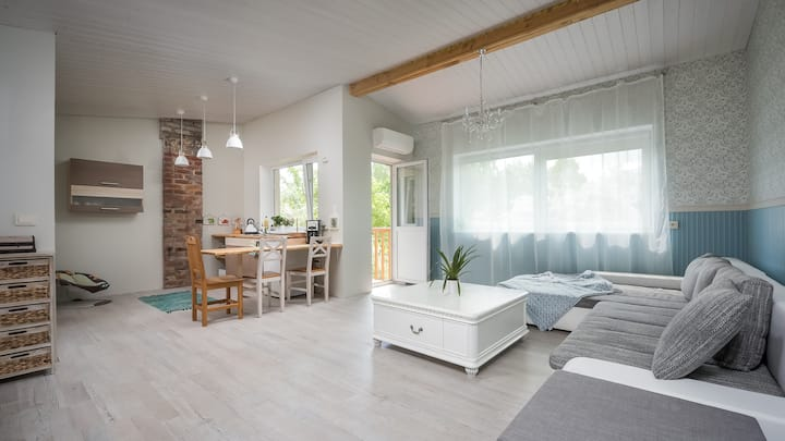 Studio with balcony and garden view