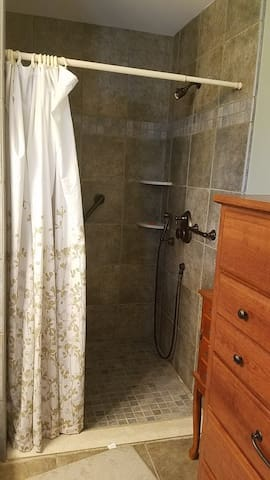 Large shower in private bathroom.