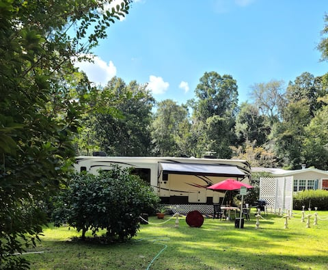 Luxury RV on private lot. Peaceful and charming.