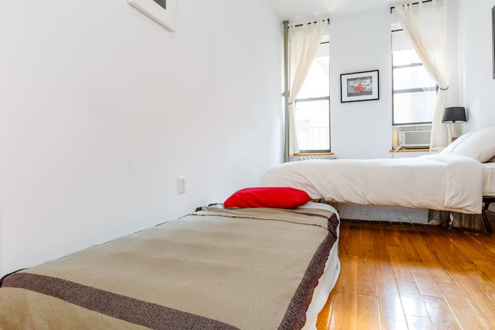 There's even an air mattress, which I'll set up if you have a third guest. Not many rooms in Lower Manhattan have this much space.
