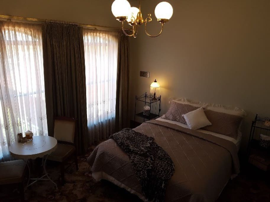 Large bedroom with NEW queensize bed, small table & 2 chairs
