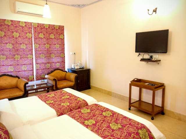 Spacious Suites come with LCD Satellite TV, Air-con, Wifi, Tea / Coffee Makers, Hair Dryers & private attached bathrooms with running hot or cold shower