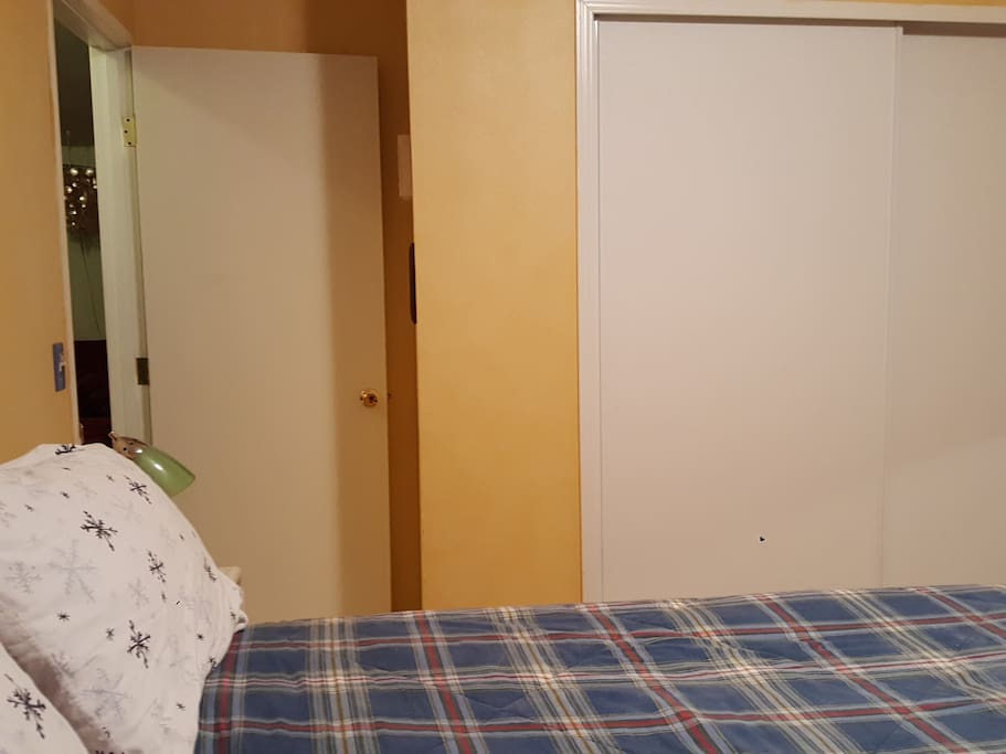 Comfy Queen bed, room is located next to the guest bath.
