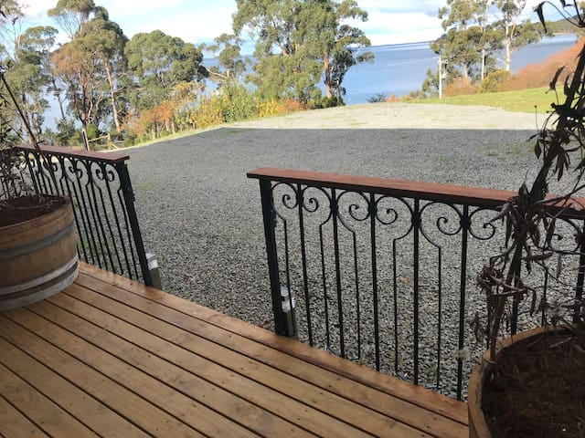 BnB deck. Bruny Island over water
