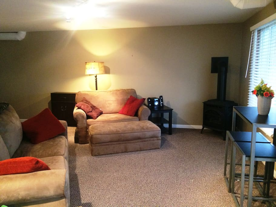 Lower level family room: 2 sofa beds, 1 additional couch, gas stove, laundry access, full bath