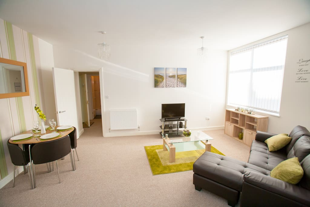 Open plan living space - living room with TV, Freeview and DVD player, dining area, fully equipped kitchen including washing machine, FREE WIFI. 2 guests beds are also available for this room.