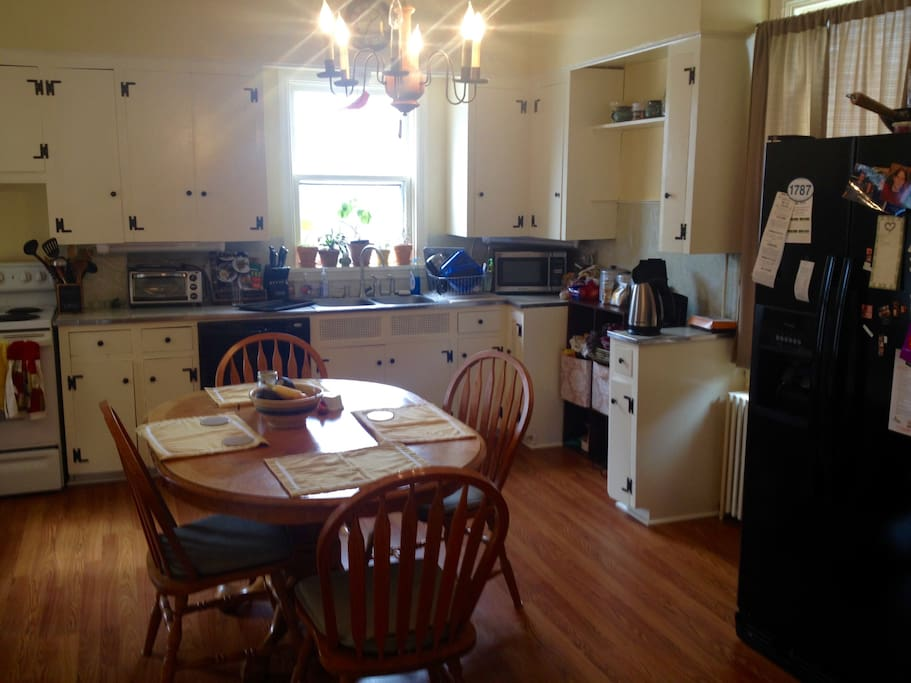 Large, open kitchen fully available for guest use (as long as you clean after yourself). Dishwasher, fridge, and entry to basement which features a washer and dryer available for guest use