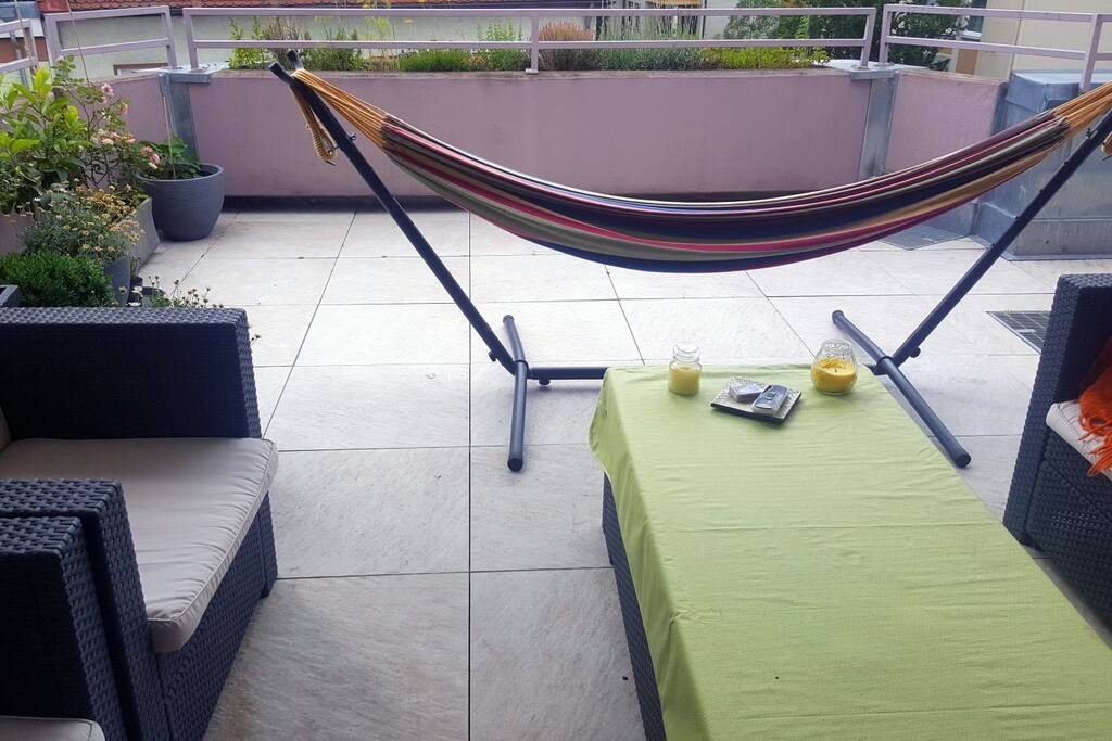 Huge balcony with hammock and fresh herbs