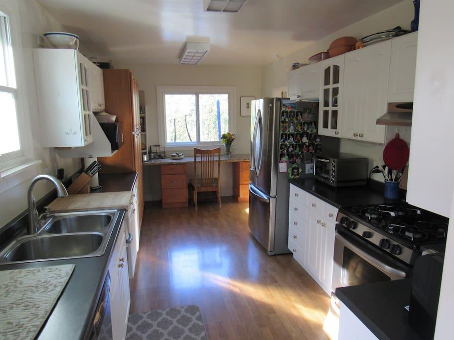 Great kitchen with stainless appliances, espresso machine, all of the kitchen essentials