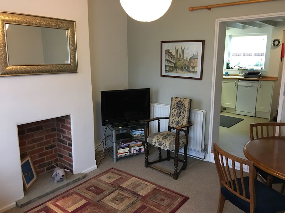 Living/Dining room with TV & DVD player.