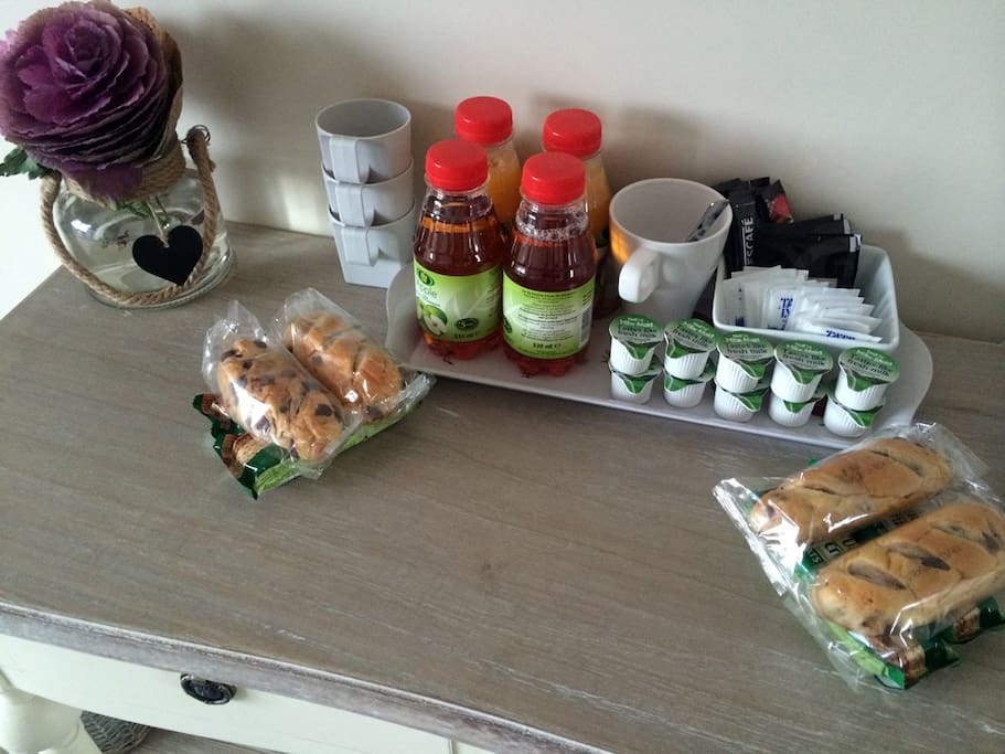 complimentary breakfast of fruit juice, brioche, breakfast cereal bar, tea and coffee.