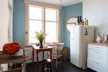 The cosy kitchen, equipped with a modern refrigerator and big stove. Pots, pans, tea and coffee are provided! Please note, this is a shared kitchen, guests staying in our attic apartment will also use it.
