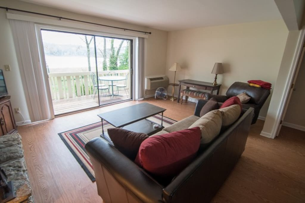 Spacious living room facing out onto The Ohio River and Charlestown State Park. Simply step out on to the balcony to enjoy the view including the stunning sunsets.
