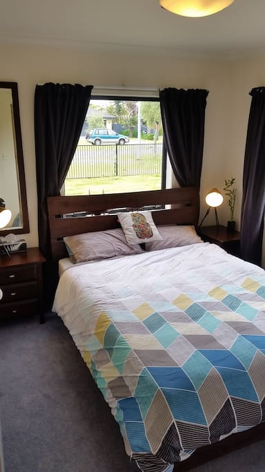 Your cosy and chic queen guest room complete with reading lamps and black-out curtains for when you want a great sleep in!