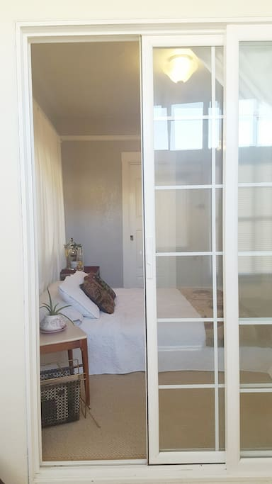 The front door leads you to an enclosed porch with a sliding glass door that enters your private bedroom