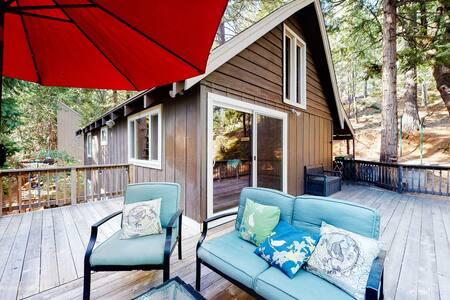 NEW LISTING! Woodsy dog-friendly cabin near town w/ scenic deck & spacious loft!