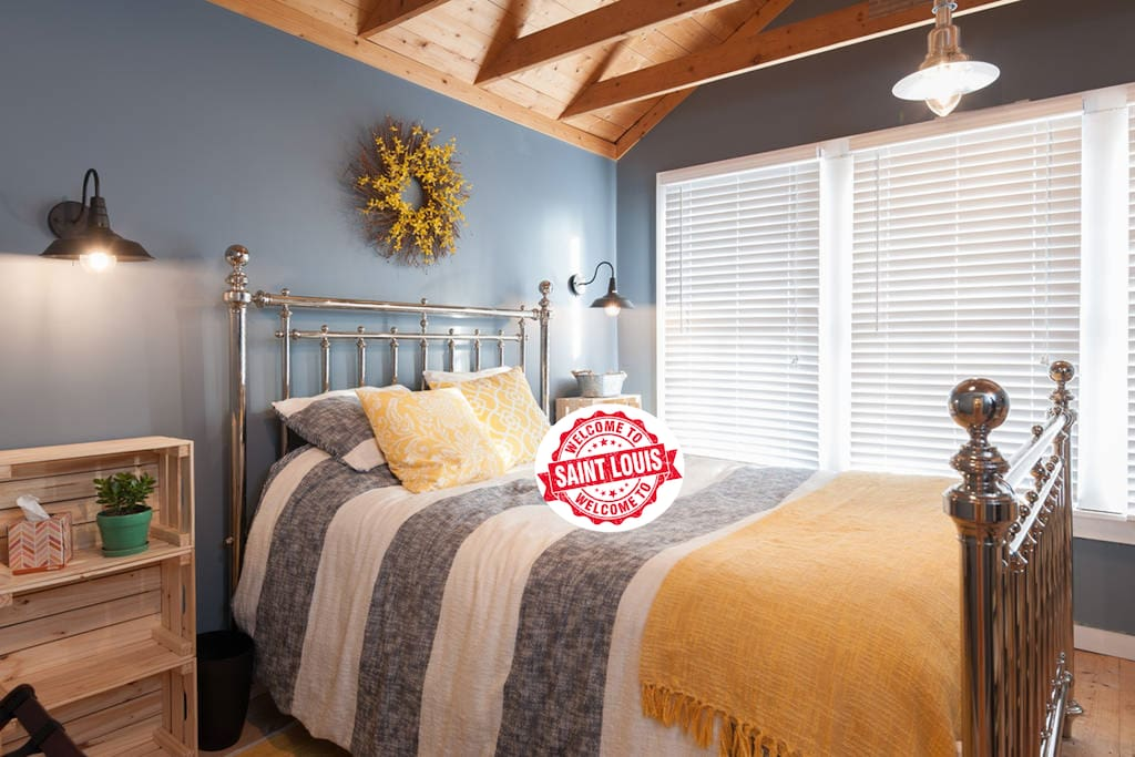 """Our modern, rustic-chic """"Farmhouse Room"""" is perfect for a pair excited to explore the city & return to a peaceful, cozy retreat. It features vaulted wood ceilings, a queen plush pillow-top mattress, small dresser, & Roku Smart TV. Room darkening curtains recently added."""