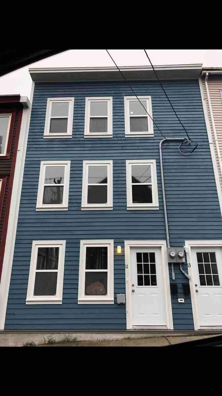 Downtown 'cotton candy blue' one bedroom rowhouse