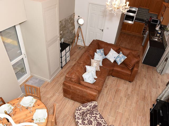 Looking down from the crog loft into open plan lounge and kitchen
