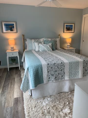 Newly remodeled master bedroom with a beautiful view of the lake